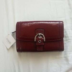 Red shinny Coach Wallet.